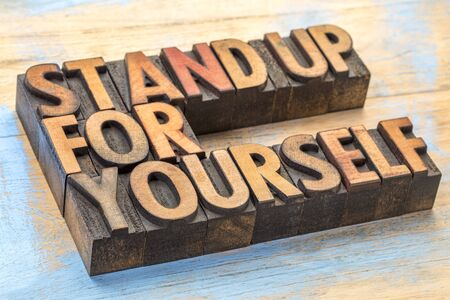 Stand up for yourself - inspirational word abstract in vintage letterpress wood type blocks Stock Photo