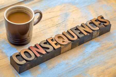 Consequences- word abstract in vintage letterpress wood type with a cup of coffee Foto de archivo - 97763055