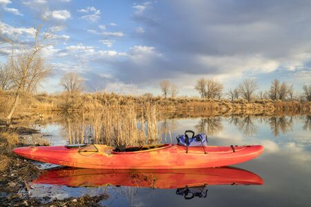 whitewater kayak on a calm lake in Colorado, early spring scenery Stock Photo