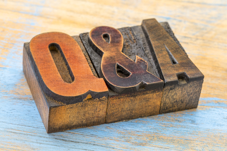 Questions and answers acronym - word abstract in vintage letterpress wood type printing blocks