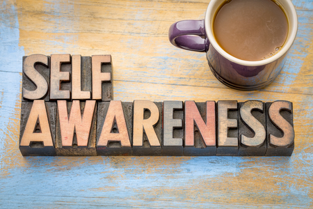 self awareness word abstract in vintage letterpress printing blocks with a cup of coffee