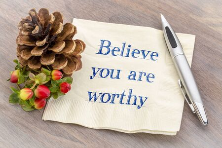 Believe you are worthy - inspirational handwriting on a napkin 스톡 콘텐츠