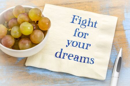 Fight for your dreams - motivational  handwriting on a napkin