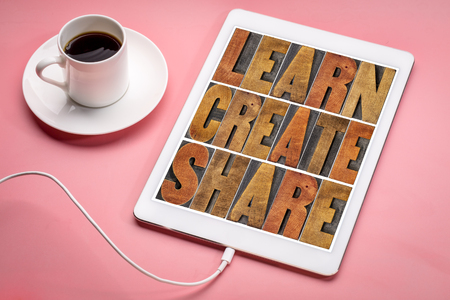learn, create and share motivational word asbtract in vintage letterpress wood type blocks on a digital tbalet with a cup of coffee