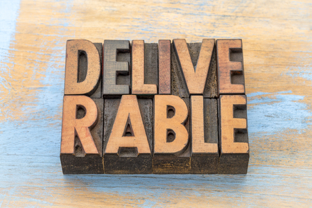 deliverable  - word abstract in vintage letterpress wood type Stock Photo