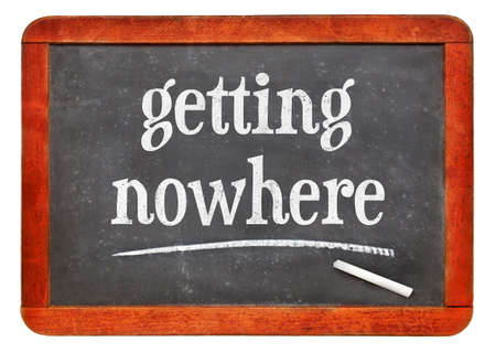 getting nowhere - white chalk text on a vintage slate blackboard