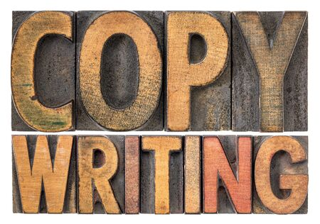 copywriting word abstract - isolated text in vintage letterpress wood type stained by color inks 免版税图像
