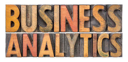 business analytics - isolated word abstract in vintage letterpress wood type blcoks stained by color inks Stock Photo