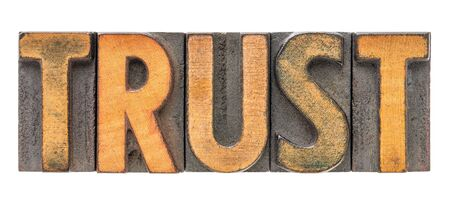 trust - isolated word abstract in vintage letterpress wood type block stained by color inks Stock Photo