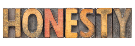 honesty  - isolated word abstract in vintage letterpress wood type block stained by color inks
