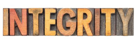 integrity  - isolated word abstract in vintage letterpress wood type block stained by color inks Stock Photo
