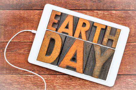 Earth Day - annual event celebrated on April 22 to demonstrate support for environmental protection, word abstract in letterpress wood type on a digital tablet