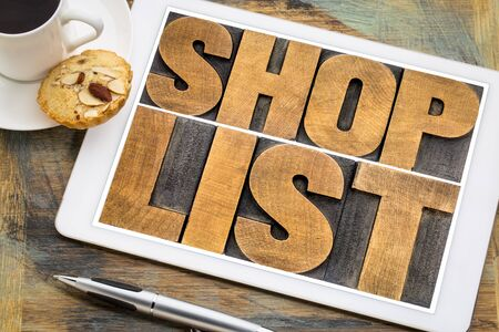 shop list word abstract typography - in letterpress wood type on a digital tablet with a cup of coffee