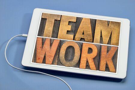 teamwork - word abstract in vintage letterpress wood type printing blocks on a digital tablet