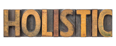 holistic - isolated word abstract in vintage letterpress wood type blocks