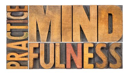 Practice mindfulness - isolated word abstract in vintage letterpress wood type printing blocks