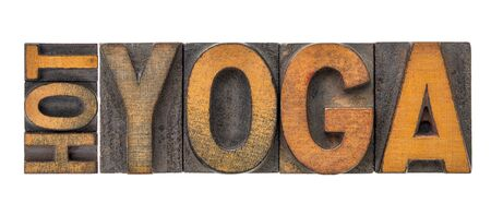 hot yoga word abstract - isolated text in letterpress wood type printing blocks stained by color inks Stock Photo
