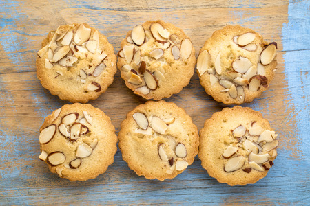 set of French almond cookies against grunge wood background Stock Photo