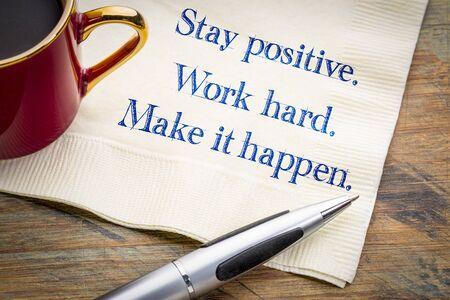 Stay positive. Work hard. Make it happen.  Inspirational handwriting on a napkin.