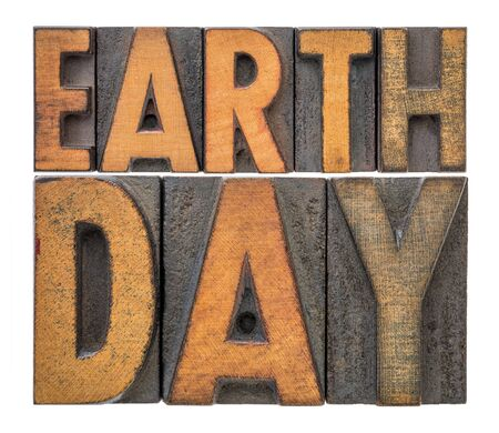 Earth Day - annual event celebrated on April 22 to demonstrate support for environmental protection, isolated word abstract in letterpress wood type