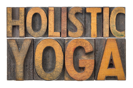 holistic yoga word abstract - isolated text in letterpress wood type printing blocks stained by color inks