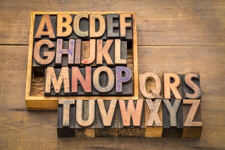 alphabet abstract in vintage wood type with a box Stock Photo