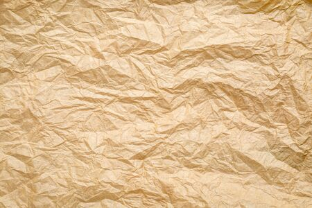 Crumpled, wrinkled and creased brown paper background