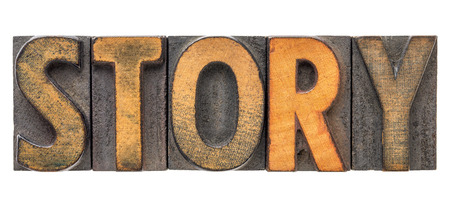 story - isolated word in vintage letterpress wood type printing blocks