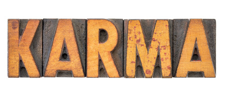 karma word abstract - isolated text in letterpress wood type printing blocks stained by color inks