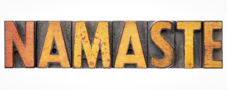 namaste isolated word abstract in vintage letterpress wood type blocks stained by color inks