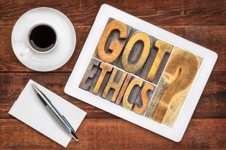 Got ethics? A word abstract in vintage letterpress wood type blocks  on a digital tablet with a cup of coffee Banco de Imagens