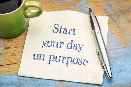 Start your day on purpose - inspirational handwriting on a napkin with a cup of coffee