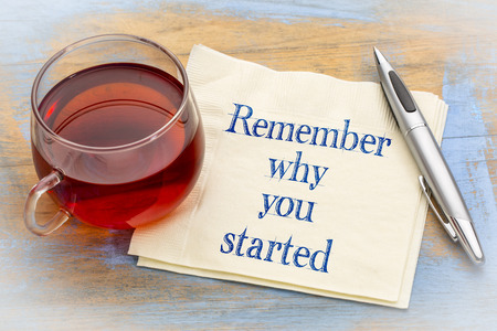 Remember why you started - inspirational handwriting on a napkin with a cup of tea Reklamní fotografie