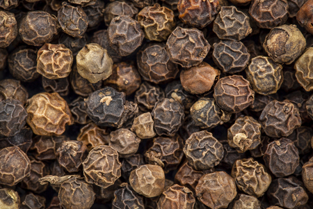 dry black Indian peppercorn background and texture