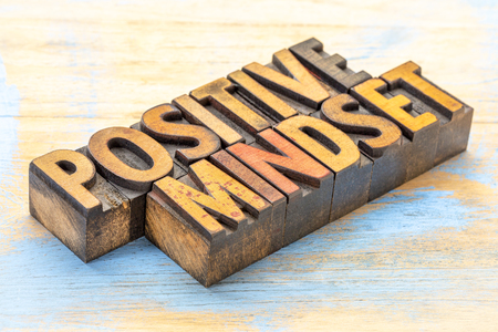 positive mindset - word abstract in vintage letterpress wood type stained by color inks Stock fotó - 100640467