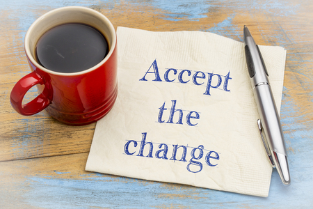 Accept the change - inspirational handwriting on a napkin with cup of coffee