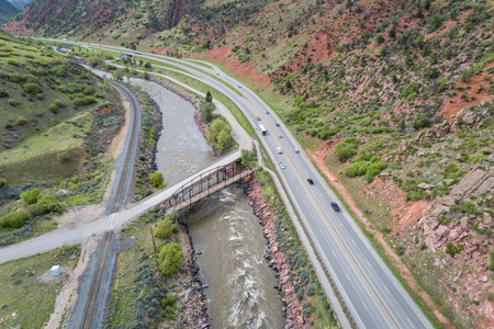 Aerial view of Colorado River and I-70 highway at South Canyon below Glenwood SPrings, Colorado Stock Photo - 101920959