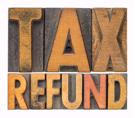 tax refund - isolated word abstract in vintage letterpress printing blocks Stock Photo