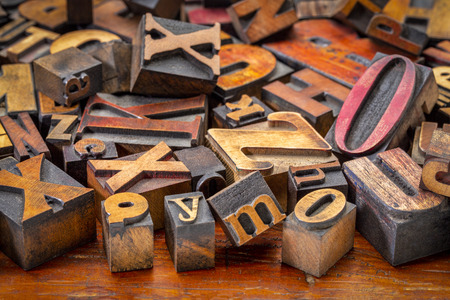 alphabet abstract - background of random letterpress wood type printing blocks, mixed fonts, top view Stock Photo