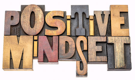 positive mindset - isolated word abstract in vintage letterpress wood type blocks, mixed fonts