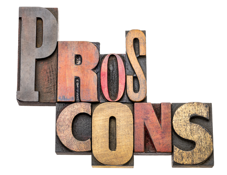 pros and cons - isolated word abstract in vintage letterpress wood type, mixed fonts - choice concept Imagens