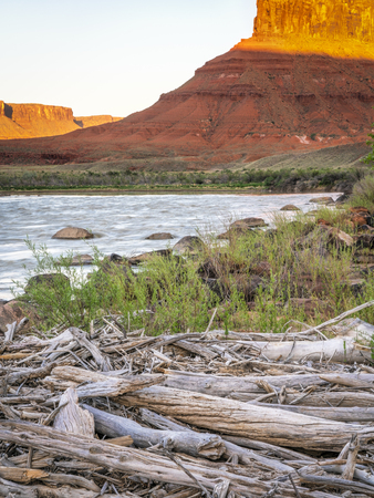 Colorado River at Rocky Rapid above Moab, Utah, sunset light Stock Photo - 102003671