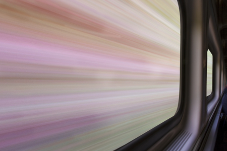 blurred abstract landscape of a sandstone canyon seen from a  train window in motion - travel concept Stock Photo