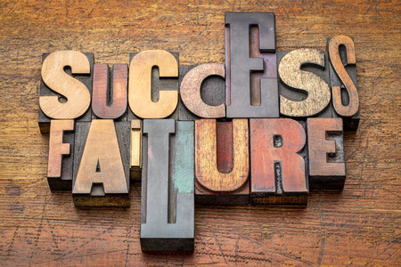 success and failure - word abstract in vintage letterpress wood type against rustic wooden background