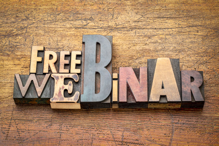 free webinar banner  -  internet communication concept - a word abstract  in vintage letterpress printing blocks stained by red ink against grunge wooden background Stock Photo - 102103503