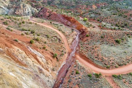 canyon road crosses a stream - Onion Creek near Moab, Utah - aerial perspective