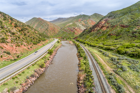 Aerial view of Colorado River and I-70 highway at South Canyon below Glenwood Springs, Colorado
