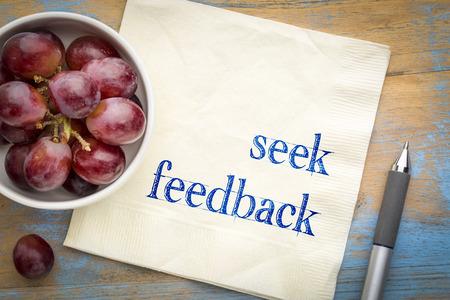 Seek feedback  advice or reminder - handwriting on a napkin with fresh grapes