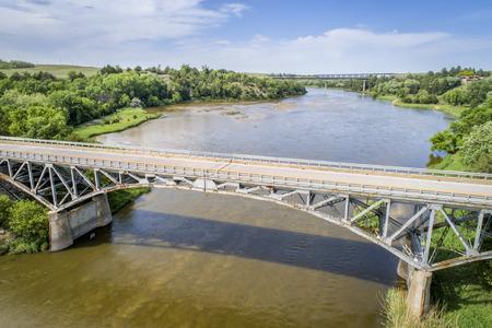Niobrara River with a historic  pin-connected arch Bryan bridge built in 1932 near Valentine in Nebraska Sandhills, aerial perspective Stock Photo