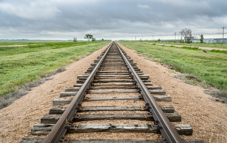 railroad tracks in a prairie of eastern Colorado - travel concept Stock Photo - 102864642